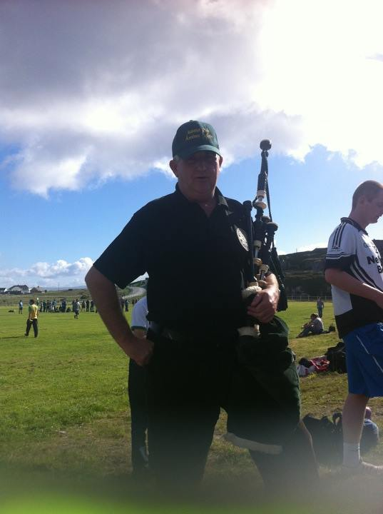 Alec Brown, Arranmore piper for the games, played the national anthem to begin tournament