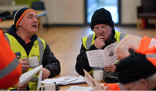 Stewards have tea and study the team sheet before todays game. Bank of Ireland Dr McKenna Cup, Semi-Final, Cavan v Derry. Athletic Grounds, Armagh