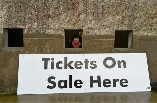 Marion Donnelly keeps dry in the ticket office. Bank of Ireland Dr. McKenna Cup, Group C, Monaghan v Ulster University, St Tiernach's Park, Clones, Co. Monaghan.