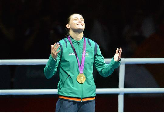 9 August 2012; Katie Taylor, Ireland, looks to the sky before receiving her gold medal. London 2012 Olympic Games, Boxing, South Arena 2, ExCeL Arena, Royal Victoria Dock, London, England. Picture credit: Brendan Moran / SPORTSFILE