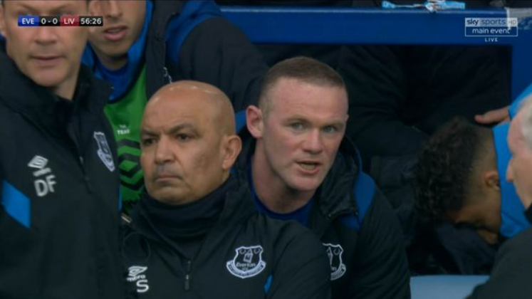 Wayne Rooney fumes after being substituted during Merseyside derby