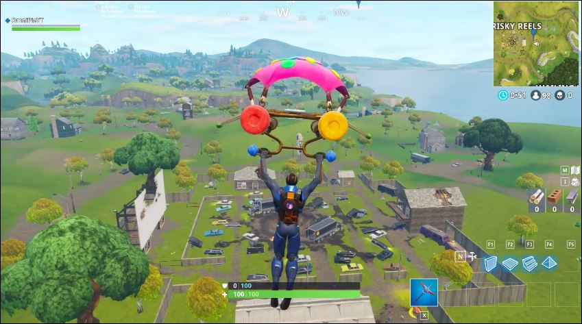 Fortnite Search Between a Scarecrow, Pink Hotrod and Big Screen Guide